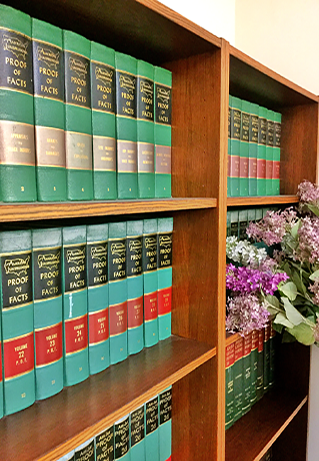 Law books at the Law Offices of Neil T. Nakamura & Associates
